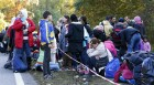 Migrants arrive at Austrian-German border in Achleiten