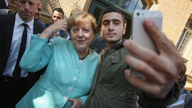 merkel migrant selfie